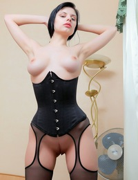 Goth girl with powder skin and red lipstick, she has a tight corset and black stockings. - Belle A - Hold Me
