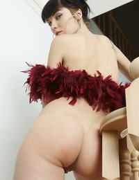 Dramatic black haired Polina shares her creamy white skin while doing her thing with the boa. - Polina D - Teasinis