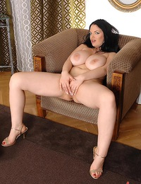 Joanna Bliss playing with her large mellons in her room